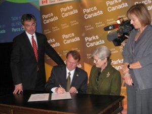 Alain Latourelle, CEO Parks Canada and Deborah Apps, President and CEO Trans Canada Trail sign the MOU