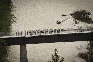 Part of the crowd that celebrated the Designation Ceremony wave from Wycliffe Bridge. Photo: Bob Whetham