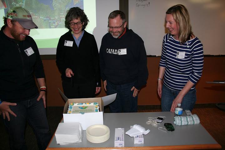 Dana Meise (the Great Hike), Ruth Marr (TCT board), David King (MRTA president), and Jane Murphy (TCT) prepare to enjoy a cake celebrating the Trans Canada Trail's 20th anniversary. Photo: Ian Hughes, MRTA