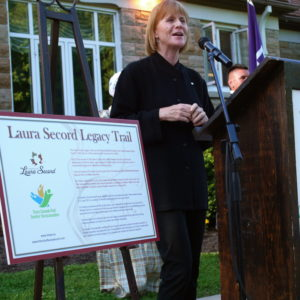 Valerie Pringle presents the new signage.