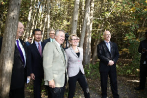 Premier Wynne and Paul LaBarge, chair of the Trans Canada Trail, walk through the Greenwood Conservation Area in Ajax, Ont. (Photo: Queen's Printer for Ontario)