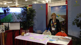 Saskatchewan Trail Coordinator Kristen Gabora at TCT's booth at this year's SARM tradeshow in Saskatoon.