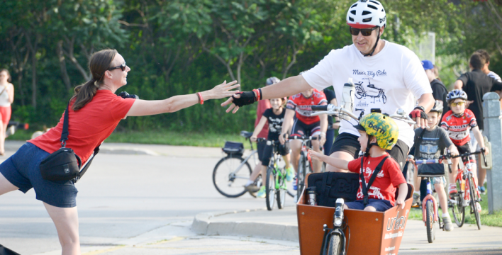 Andrew and Max reach for a high five from Mum, Kerri, at the Hamilton, ON finish line. Photo courtesy of The Hamilton Spectator