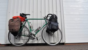 Chris Lee's bike loaded with supplies and leaning against a wall, ready for his cross-Canada journey.