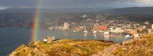 An above point of view of St John's Newfoundland. There is a rainbow on the left