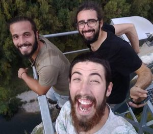 Three guys from the bearded travellers hiking groups are smiling to the camera.