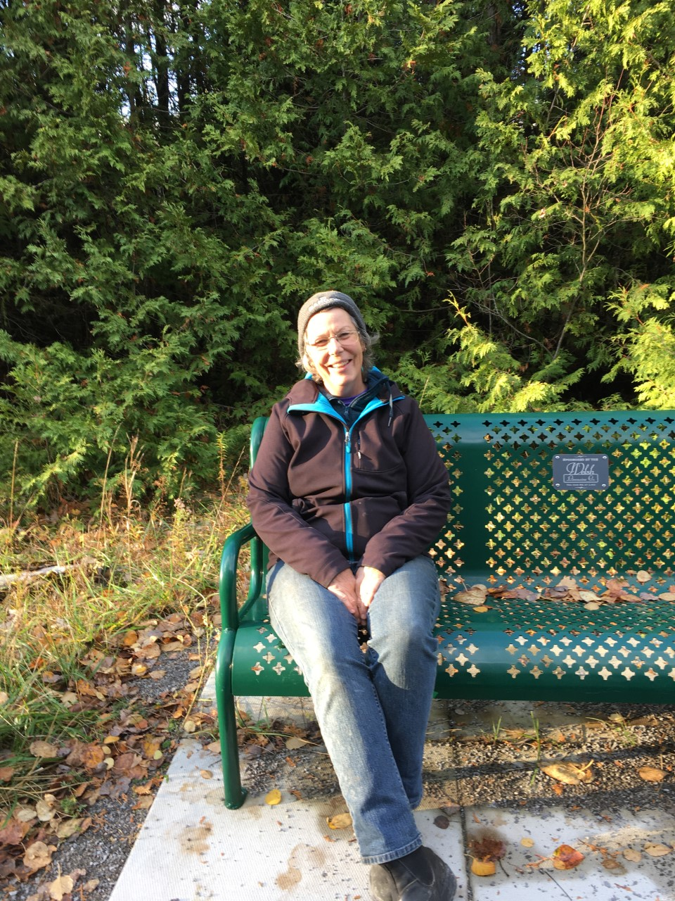 Audrey Keitel sitting on a bench on the Trans Canada Trail.